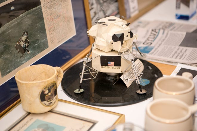 A model of the Apollo 11 LM-5 sits with Marcus Goodkind's space memorabilia. He worked as the Spacecraft Test Manager for the lunar module.