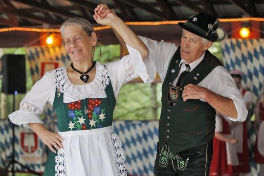 The Edelweiss Schuhplattlers' Gracie Schell and Karl Wuerslin demonstrate polka dancing during the Sommer Biergarten Festival at the German-American Club in Binghamton in 2017.