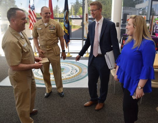 Capt. Jeffrey Bitterman, Naval Hospital Bremerton commanding officer, and Command Master Chief Robert Stockton, provide U.S. Rep. Derek Kilmer, D-Gig Harbor, a tour of their command that included the labor and delivery department, urgent care clinic and pharmacy, on July 1.