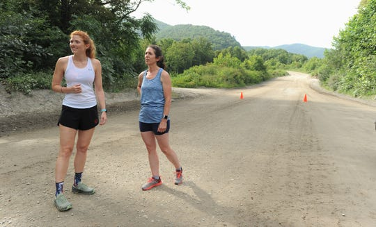 Amanda Stackhouse, left, and Jane Dean   get ready to run the trails at Grove Stone & Sand as they prepare for Asheville Spartan Race on July 27 and 28.