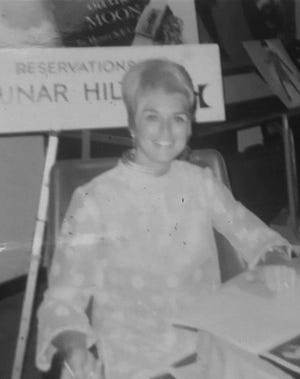"Sharon Rhodes Crockett of Rockledge is pictured in July 1969 during the Apollo 11 launch and moon landing week. Then 26 and a Boeing secretary, she took reservations for the future 'Lunar Hilton"" during a promotion at Cape Kennedy Hilton."