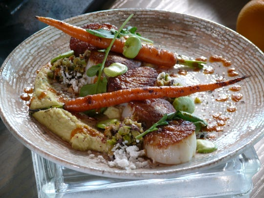 The scallops entree at at the Toledo Restaurant on the 16th. floor of the new Gran Destino Tower.