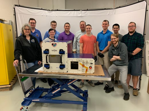 Most of the 3D BioFabrication  Facility team, just prior to packing for shipment.  Tech companies nScrypt and Techshot worked together to develop the first 3D printer that could print human tissue in space.