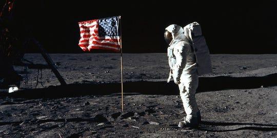Buzz Aldrin, lunar module pilot, walks near the lunar module during the Apollo 11 extravehicular activity.