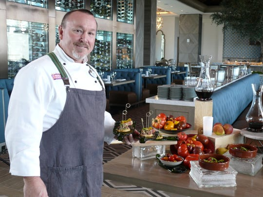 Gran Destino Tower executive chef Robert Sayles with tapas selections.