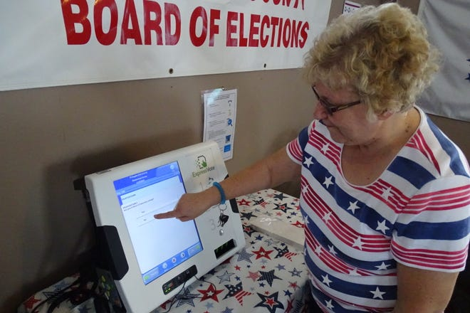 Crawford County Board of Elections Director Ruth Leuthold demonstrates how to use the county's new ExpressVote voting machines during the Crawford County Fair.