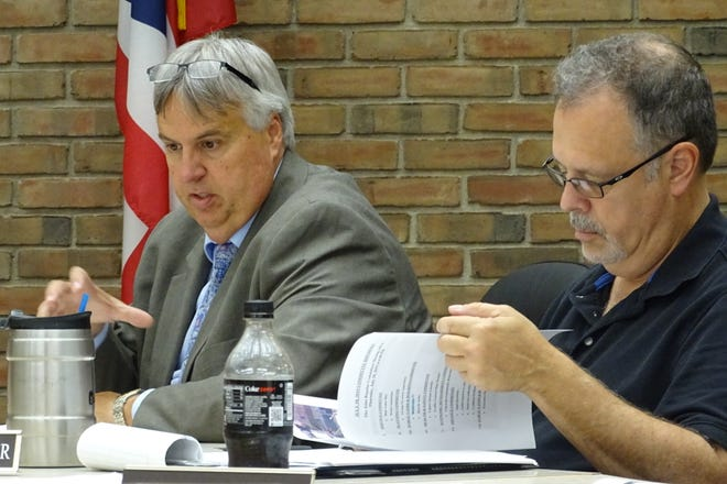City Law Director Rob Ratliff, left, explains what he learned during a meeting with a potential buyer for the Pines Reservoir and ODNR officials during Thursday night's Public Lands and Buildings Committee meeting. Council member Mark Makeever is at right.