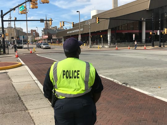 A Camden County police officer monitors traffic at Broadway and Martin Luther King Boulevard in Camden.