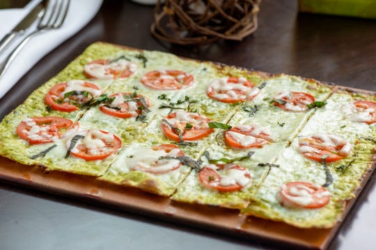 Pesto Caprese Flatbread: Tomato, Basil Pesto, Fresh Mozzarella from Harvest Seasonal Grill.