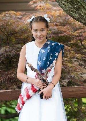 Bishop Flaget student Bella Flores received second place for her speech about unity during the God, Country and Flag national contest.