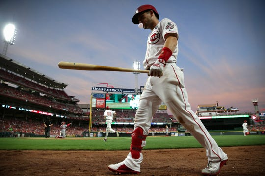 Cincinnati Reds second baseman Scooter Gennett (3) walks to the on-deck circle in the fifth inning of an MLB baseball game against the St. Louis Cardinals, Thursday, July 18, 2019, at Great American Ball Park in Cincinnati.
