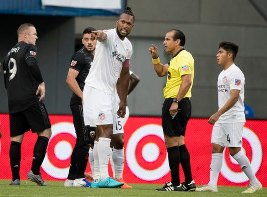 FC Cincinnati defender Kendall Waston (2) argues with the official in the first half of the MLS soccer match between FC Cincinnati and D.C. United on Thursday, July 18, 2019, in Cincinnati.