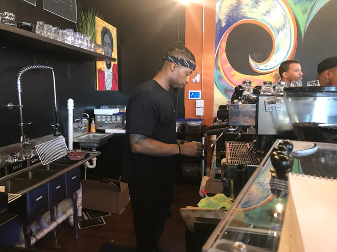 Means Cameron behind the coffee bar at blaCk Coffee Lounge  on July 19 at 824 Elm St.