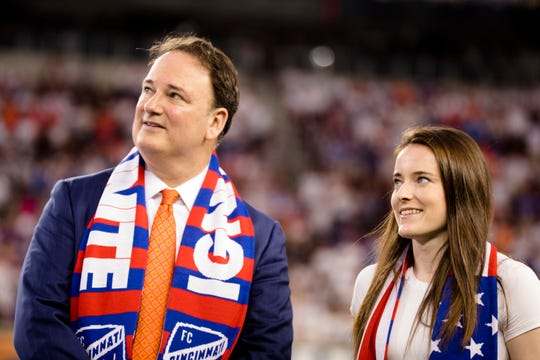 Jeff Berding, FC Cincinnati president, stands next to US women's soccer player Rose Lavelle at halftime of the MLS soccer match between FC Cincinnati and D.C. United.