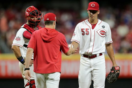 Cincinnati Reds relief pitcher Robert Stephenson (55) is pulled from the game from Cincinnati Reds manager David Bell (25) in the sixth inning of an MLB baseball game, Thursday, July 18, 2019, at Great American Ball Park in Cincinnati.