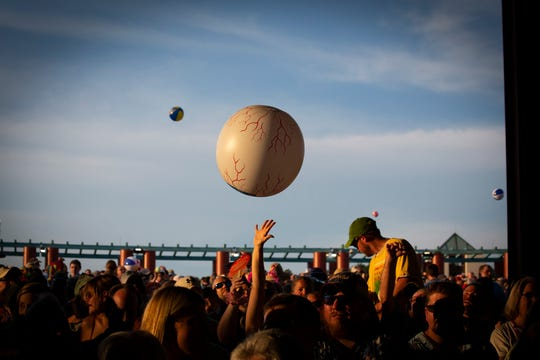 People throw beach balls into the air during the Jimmy Buffett & The Coral Reefer Band concert at Riverbend Music Center on Thursday, July 18, 2019.
