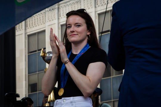 Rose Lavelle claps on stage during her visit to Fountain Square on Friday, July 19, 2019.
