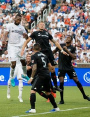 FC Cincinnati defender Kendall Waston (2) heads the ball as D.C. United defender Frederic Brillant (13) defends in the first half of the MLS soccer match between FC Cincinnati and D.C. United on Thursday, July 18, 2019, in Cincinnati.