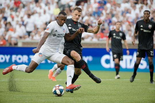 FC Cincinnati forward Rashawn Dally (81) goes to shoot D.C. United midfielder Russell Canouse (4) in the first half of the MLS soccer match between FC Cincinnati and D.C. United on Thursday, July 18, 2019, in Cincinnati.
