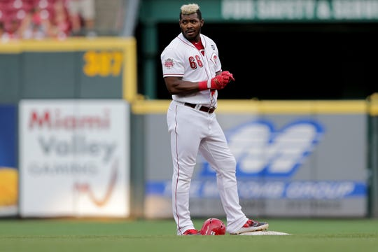 Cincinnati Reds right fielder Yasiel Puig (66) stands on second base after hitting a double in the third inning of an MLB baseball game against the St. Louis Cardinals, Thursday, July 18, 2019, at Great American Ball Park in Cincinnati.