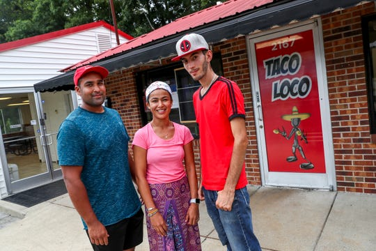 Pat Williams, left, Natcha, center, and Tony Villafane, right, pose for a portrait outsidentheir restaurant at Taco Loco on Fort Campbell Blvd in Clarksville, Tenn., on Thursday, July 18, 2019.
