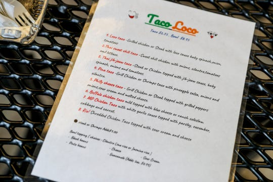 The in-house menu for Taco Loco as seen at a table in their indoor dining area at Taco Loco on Fort Campbell Blvd in Clarksville, Tenn., on Thursday, July 18, 2019.