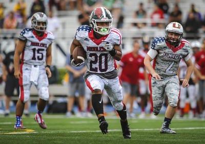 Middlesex's Jordan Davis of St. Joseph (Met.) breaks free for extra yards during the Autoland Classic football game on Thursday, June 18, 2019 at Kean University.