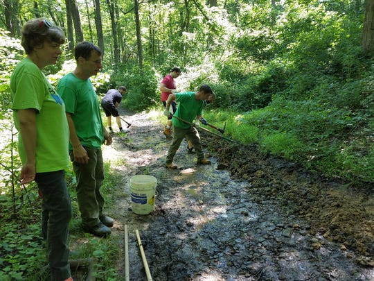 Agroup of employees from BASF in Florham Park volunteered their time to help restore part of a hiking trail in Union County's Watchung Reservation in June.
