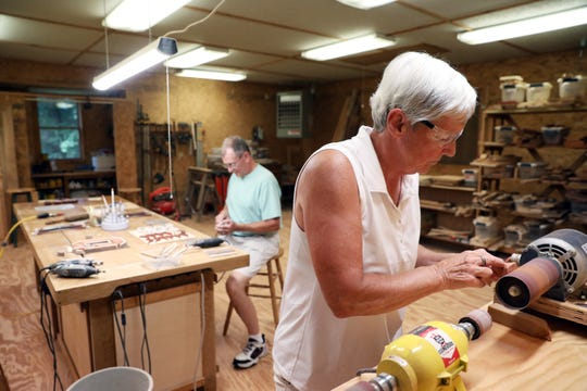 Jane Mautz and her husband Rick put together products in their workshop. In 2011, they made their first intarsia pieces for family. In 2015, they officially started an intarsia woodworking business under Jane's already established name of Pine Gap Woodworks.