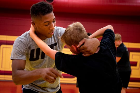 Iowa State redshirt freshman wrestler David Carr teaches a move to a wrestling camper on Wednesday, July 10, 2019, in Ames, Iowa.