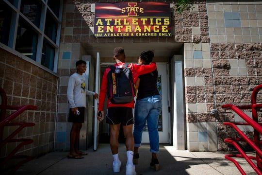 Iowa State redshirt freshman wrestler David Carr walks into the Lied Recreation Athletic Center with his mom, Linda, on Tuesday, July 9, 2019, in Ames, Iowa.
