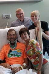 Jay Ustruck (front left) will ride RAGBRAI less than a year after being hit by a car while cycling in Florida. He is pictured in recovery with his wife Georgine and Wayne and Karen Martens (back row), the Iowa natives who welcomed him to Team Moore On.