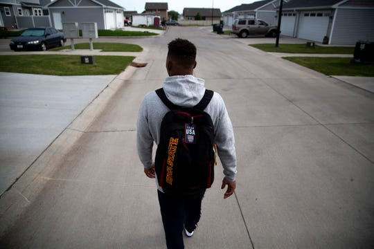 The Junior World Championships are approaching, but Iowa State redshirt freshman wrestler David Carr knows there are even bigger matches in his future. Here he walks to his car on his way to practice on Wednesday, July 10, 2019, in Ames, Iowa.