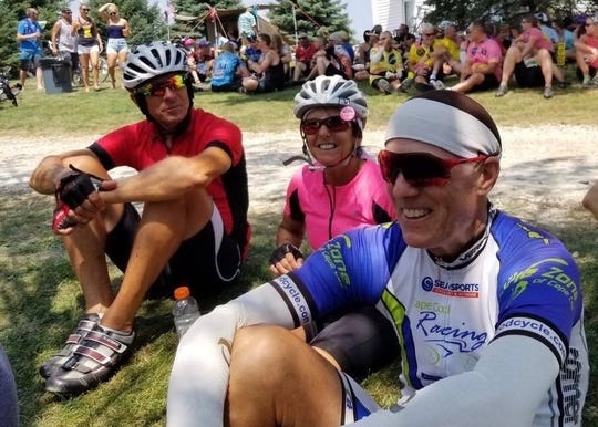 Jay Ustruck (left), Georgine Ustruck (center) and Jack Harrison (right) relax during RAGBRAI 2018. Harrison and Jay Ustruck were cycling together in Florida last October when their group was hit by a car from behind. Harrison died from his injuries a week later.