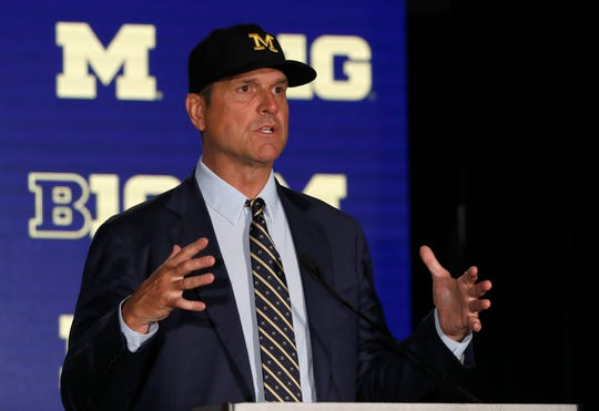 Michigan coach Jim Harbaugh responds to a question during the Big Ten media days on Friday, July 19, 2019, in Chicago.