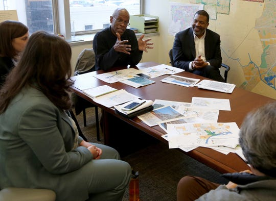 Maurice Cox, gesturing, director of the City of Detroit Planning and Development Department, makes a point  during a meeting in his office at the Coleman A. Young Municipal Center in Detroit on Friday, December 16, 2016.