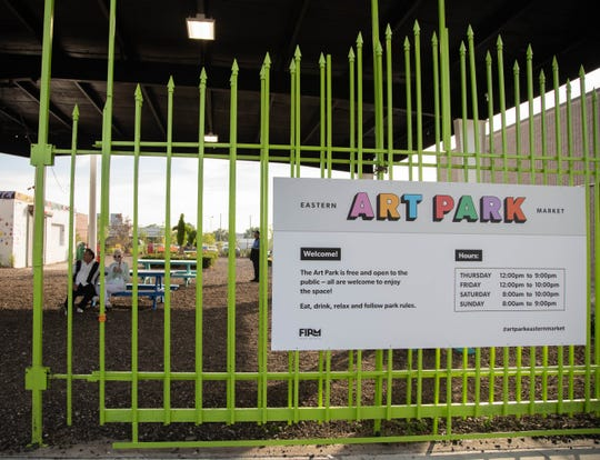 The gates in front of Art Park on the corner of Russel and Alfred during the Art Park grand opening at Eastern Market on Thursday, July 18, 2019.