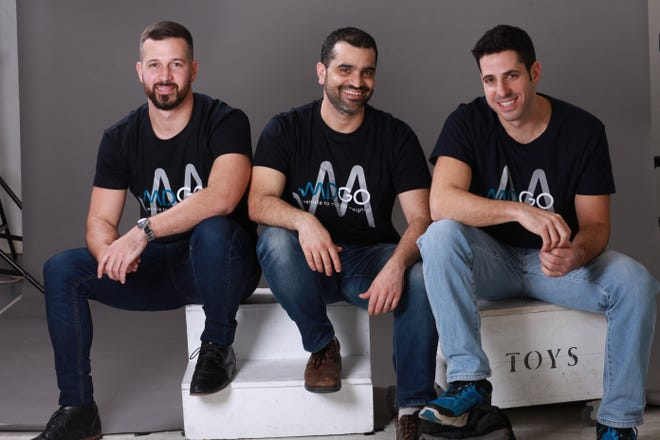 Three top executives at the Israeli start-up MDGo - Eli Zerah, Gilad Avrashi and Itay Bengad, pictured from left to right - are hoping to revolutionize how first responders dispatch to car crashes. Their technology applies artificial intelligence to car sensor data to try to predict what kind of injuries may have been sustained. That information is sent almost immediately to EMS before they arrive, company officials said.