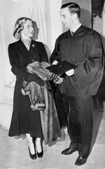 William Clay Ford, grandson of the late Henry Ford, and a director of the Ford Motor Company, is congratulated by his wife, Martha Parke Firestone, daughter of tire manufacturer Harvey S. Firestone, at New Haven, Conn., Feb. 5, 1949, after Ford received his Bachelor of Arts degree from Yale University.