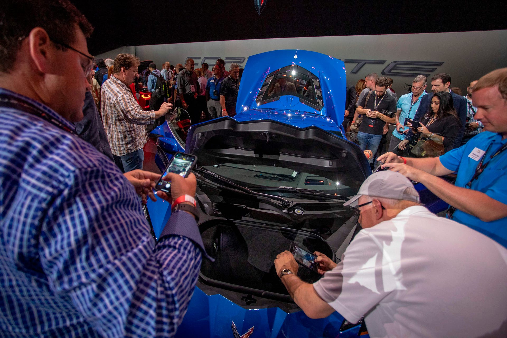 People look at the new mid-engine 2020 Corvette Stingray at the Next Generation Corvette Reveal event in Irvine, California on July 18, 2019.