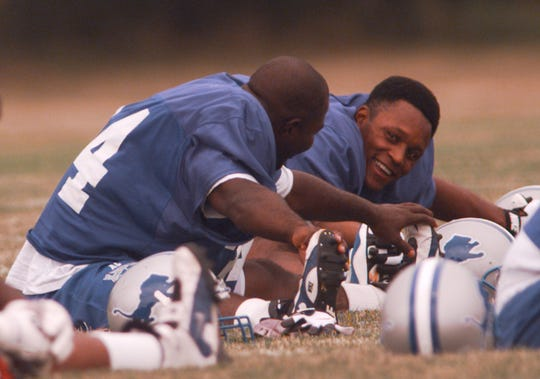 Detroit Lions running backs Ron Rivers, left, and Barry Sanders talk during warm-ups at at Saginaw Valley State University on July 21, 1997.