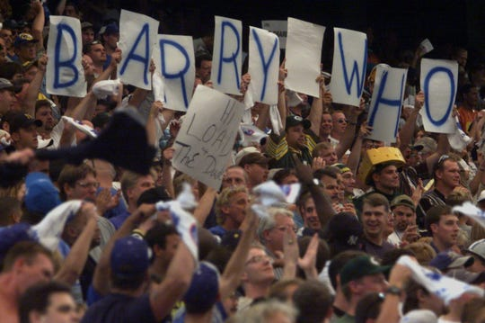 "Detroit Lions  fans ask the question, ""Barry Who?"" after a Charlie Batch touchdown run late in the second half of a 23-15 win against the Green Bay Packers on Sept. 19, 1999, at the Pontiac Silverdome. The win made the Lions 2-0, part of a 6-2 start that helped push them to the playoffs months after Barry Sanders' abrupt retirement on the eve of training camp."
