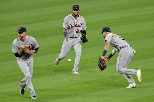 A batted ball falls between Detroit Tigers shortstop Jordy Mercer (left) and center fielder Victor Reyes (22) and right fielder Nicholas Castellanos (9) against the Cleveland Indians in the eighth inning at Progressive Field. Cleveland baserunner Greg Allen (not pictured) was forced out at second base on Thursday, July 18, 2019, in Cleveland.