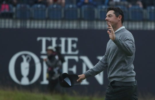 Northern Ireland's Rory McIlroy waves after completing his second round on the 18th green during the second round of the British Open.
