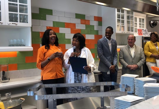 City Council President Brenda Jones presents chef and owner Quiana Broden with the Spirit of Detroit award at her cafe's grand opening last month.