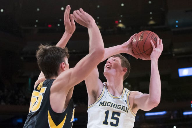 The last time Jon Teske (15) and Michigan visited Madison Square Garden, the Wolverines won four games in four days to win the 2018 Big Ten tournament title.
