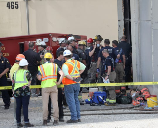 The workers became trapped Friday morning inside the silo operated by The Andersons.