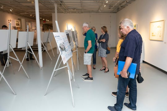 Birmingham residents look over renderings of a new proposed parking structure for which the city is seeking approval of a $57.4 million bond, during a community meeting last week at the Birmingham Bloomfield Art Center.