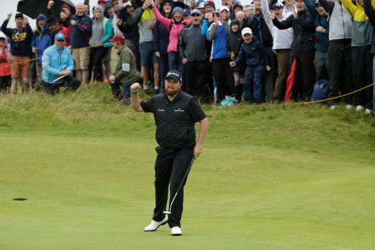 Shane Lowry pumps his fist after making a birdie at the 10th hole during the second round.