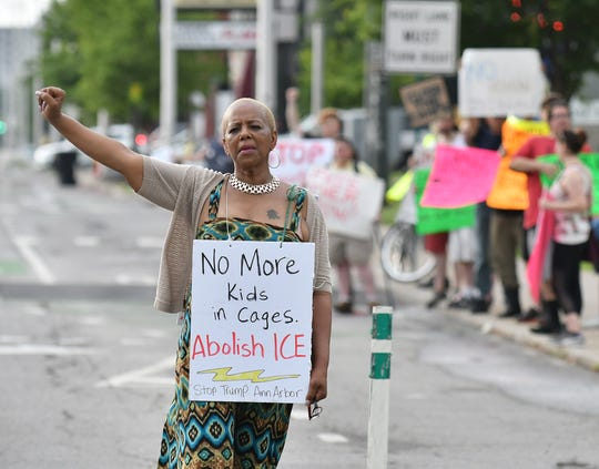 Cynthia A. Johnson, state representative. from the 5th District, walks along E. Jefferson while others protest in front of the ICE Detroit Field Office in Detroit Friday.